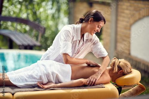 Young masseuse massages woman Canvas Print
