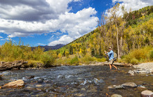 Fly Fisherman In Action On Rocky Mountain Stream Near Telluride, CO.