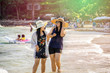 Young asian woman having fun at tropical beach on vacation, Couple of asian girl walk on the beach with bright sun light, Samed island, Thailand, Chubby girl enjoying on the sea, Lifestyle concept