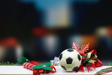 Soccer Christmas With Football And Christmas Ornament On Black Background
