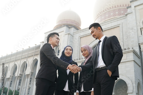 Muslim Asian business people shaking hands with new partner, business co-working teamwork concept Canvas Print