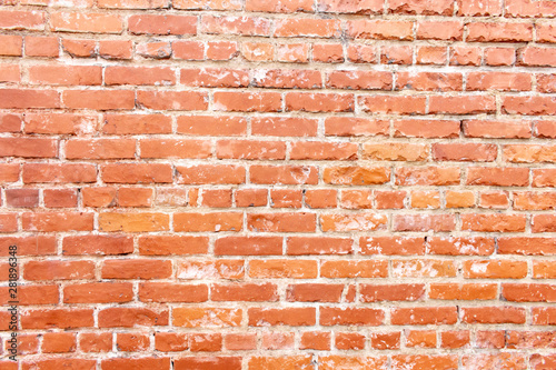 A rustic red brick background