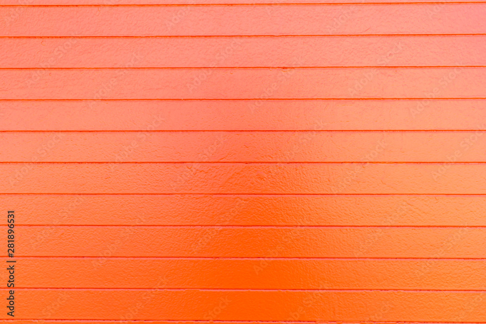 Fototapeta Smooth orange painted concrete surface with lines