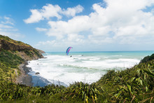 Spectacular View Of Muriwai Beach, Auckland Area, North Island Of New Zealand.  Muriwai Is  A Popular Recreational Area For Aucklanders. Paragliding, Sport, Vacation, Leisure Activity, Travel
