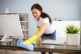 Fototapeta Panels - Janitor Cleaning Desk With Napkin