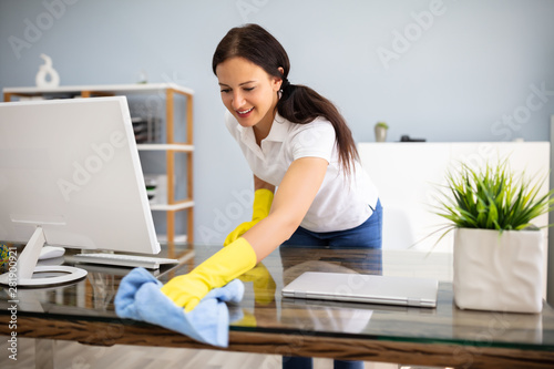 Janitor Cleaning Desk With Napkin - 281900921