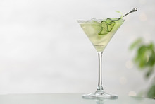 Glass Of Tasty Cucumber Martini On Table Against Light Background, Space For Text