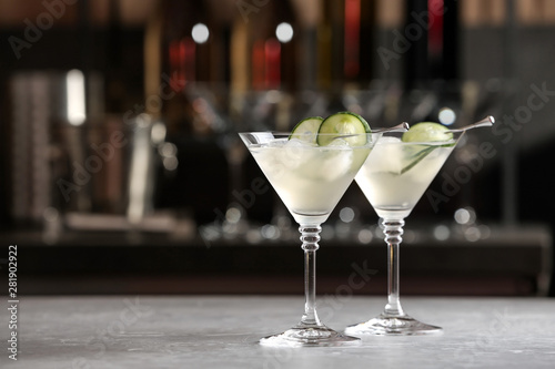 Fotografie, Obraz  Glasses of tasty cucumber martini on bar counter, space for text