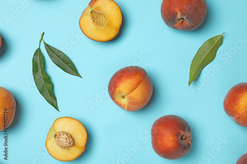 Flat lay composition with sweet juicy peaches on light blue background
