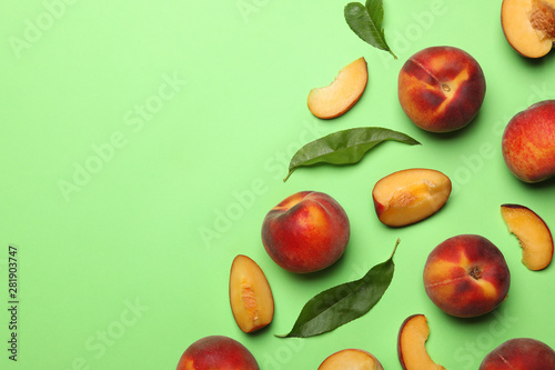 Canvas Prints Countryside Flat lay composition with sweet juicy peaches on green background, space for text