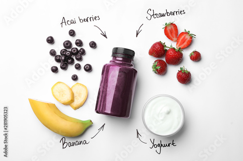 Bottle of acai drink, ingredients and written product's names on white background, top view - 281905323