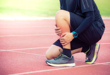 Male Runner Shin Bone Injury And Pain On Running Track,Injury From Workout Concept