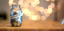 Jar Full Of Coins For Donation