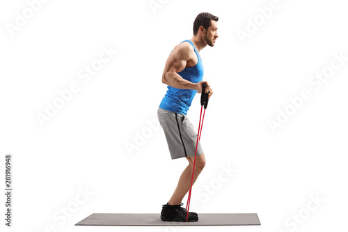 Stampa su Tela Man on an exercise mat with a resistance band