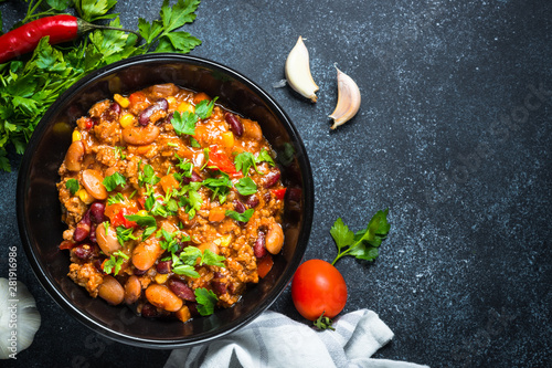 Garden Poster Personal Chili con carne from meat and vegetables on black table top view