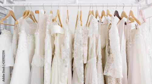 Leinwand Poster Beautiful bridal dress on hangers