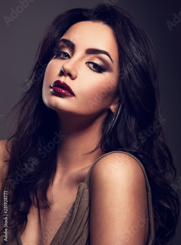 Photo sur Toile Les Textures Beautiful bright makeup woman with long black curly hair style, burgundy lipstick with vamp look on grey background. Closeup
