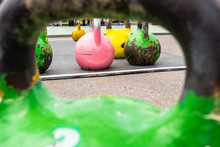 Colored Kettlebells On The Playground.
