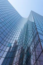 Blue Glass Skyscraper Facade Reflections Against Sky