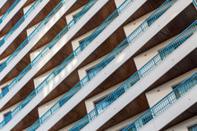 High Rise Building With Blue Rails And Wood Slatted Seling Photographed While Traveling In Malaga, Spain