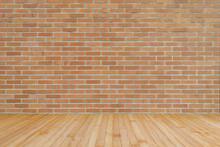 Dark Orange Brown Brick Wall Texture Background With Wooden Floor In Yellow Brown