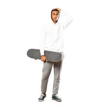 Full-length Shot Of Afro American Skater Man Over Isolated White Background