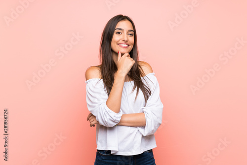 Young woman over isolated pink background smiling Fototapet