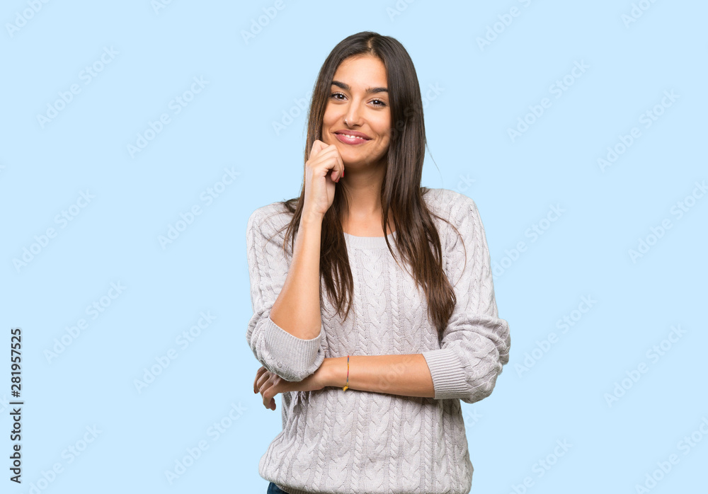Fototapeta Young hispanic brunette woman smiling over isolated background