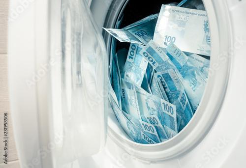 Fototapeta  Brazilian money, hundreds of reais in the washing machine