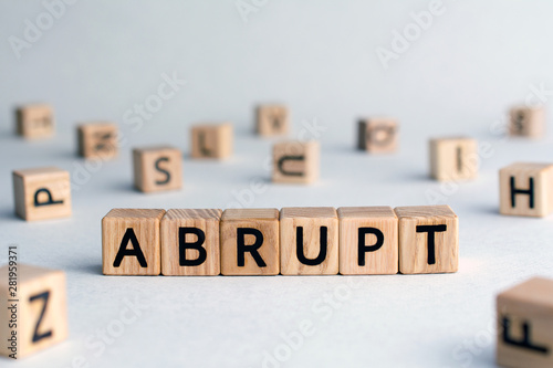 abrupt - word from wooden blocks with letters, sudden and not expected or not fr Canvas Print