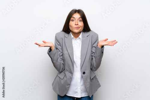 Pinturas sobre lienzo  Young business woman over isolated white background having doubts while raising