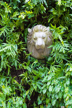 Statue Of A Lion's Head Among ...