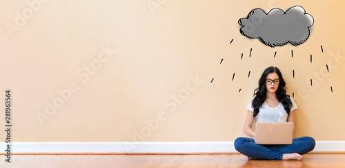 Staande foto Wanddecoratie met eigen foto Rain cloud with young woman using a laptop computer