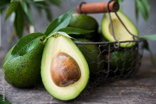 Fotografiet Fresh green avocado on wooden background