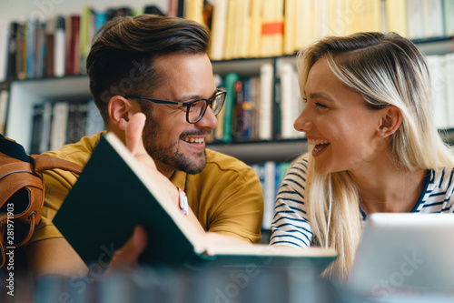 Happy young university students friends studying with books at university - Stoc Canvas Print