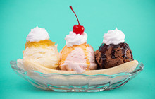Classic Banana Split On A Bright Teal Background