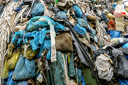 Photo  garbage dump with plastic garbage bags