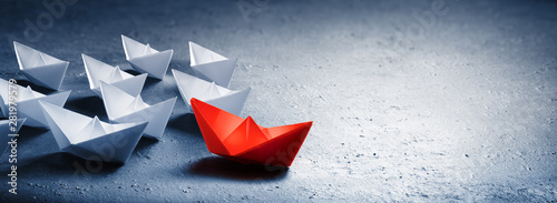 Fotografía  Red Leader Paper Boat Leading Group Of Paper Boates