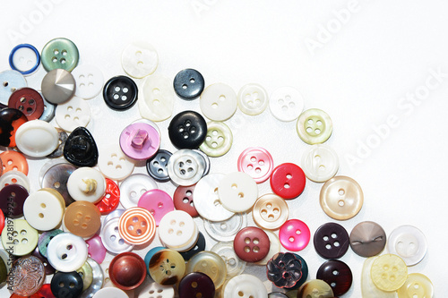 Macarons Multi-colored sewing buttons of different sizes and shapes on an isolated background