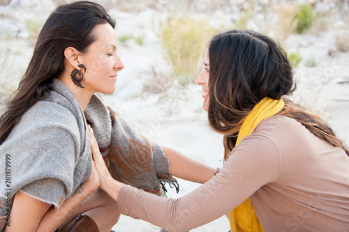 Fototapeta Two Wild Women connecting hearts in desert wilderness nature.