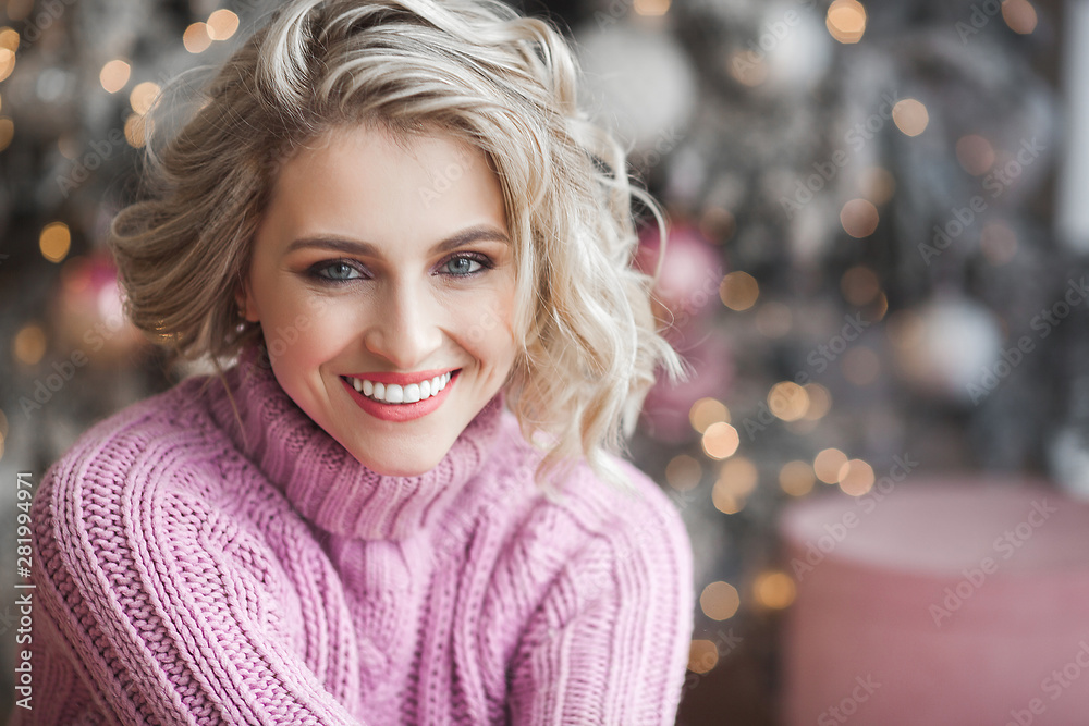 Fototapeta Closeup portrait of very beautiful young woman on christmas background. Attractive female portrait indoors. Perfect blond woman.