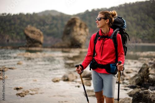 Fototapeta Portrait of trekking girl with hiking equipment obraz