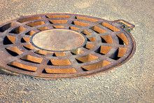 Cast-iron Manhole Of The Storm Sewer System In The Park.