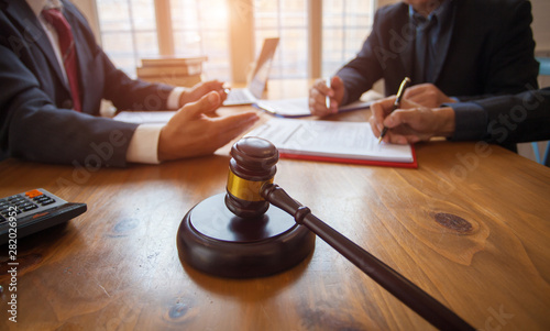 Obraz Group of business people and lawyers discussing contract papers ,Consultation between a male lawyer and businessman concept - fototapety do salonu