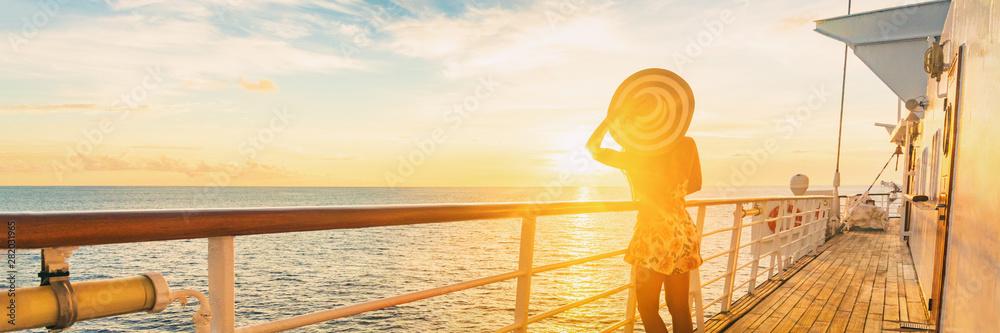 Fototapeta Cruise ship luxury vacation travel elegant woman watching sunset over Caribbean sea on deck boat summer tourist destination panoramic banner. - obraz na płótnie