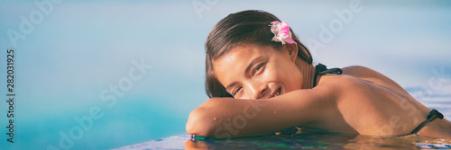 Recess Fitting Height scale Spa wellness woman relaxing in blue panoramic banner. Happy Asian woman at luxury hotel resort overwater infinity pool.