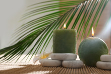 Composition With Spa Stones And Candles On Bamboo Mat