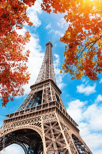 Poster Tour Eiffel Eiffel Tower against the blue sky and autumn trees in Paris, France. Famous travel destination