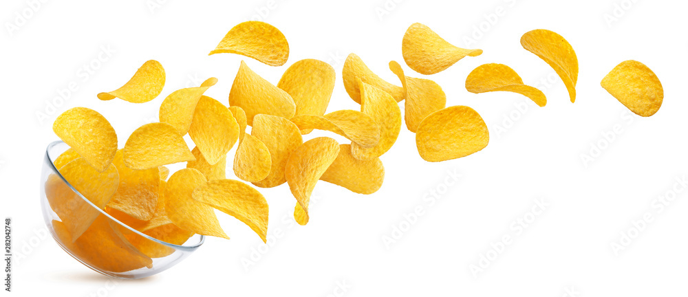 Fototapeta Potato chips falling into glass bowl isolated on white background