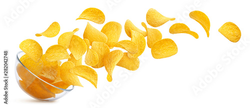 Cuadros en Lienzo Potato chips falling into glass bowl isolated on white background